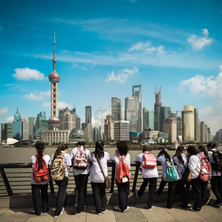 Photo for Shanghai skyline with a row of student visitors - Royalty Free Image