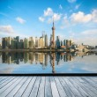 Shanghai skyline in afternoon and reflection with ...