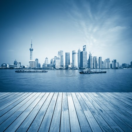 Photo for Shanghai skyline and wooden floor with blue tone,beautiful scenery of the huangpu river. - Royalty Free Image