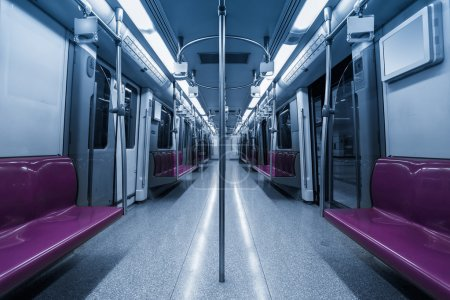 Photo for Inside the subway cars,empty purple seat - Royalty Free Image