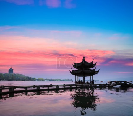 Photo for Beautiful hangzhou in sunset, ancient pavilion silhouette on the west lake,China - Royalty Free Image