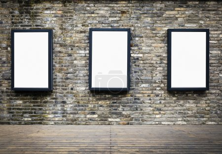 Photo for Three blank billboards attached to a building exterior old brick wall - Royalty Free Image