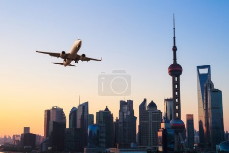 Photo for Shanghai modern buildings skyline with airplane in sunris - Royalty Free Image