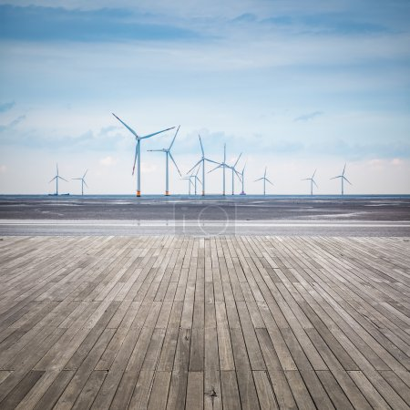 wind farm in mud flat with wooden floor