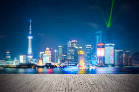 Photo for Dreamlike city background of shanghai skyline at night , light show with wooden floor prospec - Royalty Free Image