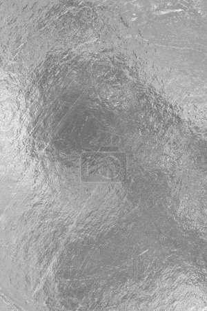 Photo pour Feuille de papier d'argent rayures de surface et taches sombres - image libre de droit
