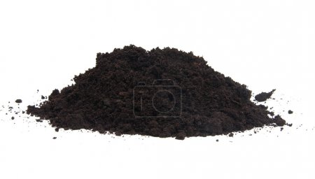 Photo for Pile of black garden top soil over white background - Royalty Free Image