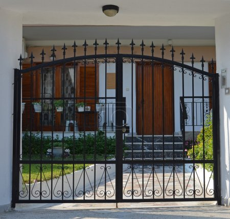 Photo for Metal modern gate for the small house - Royalty Free Image