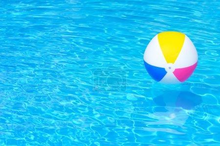 Photo for Inflatable ball floating in swimming pool - Royalty Free Image