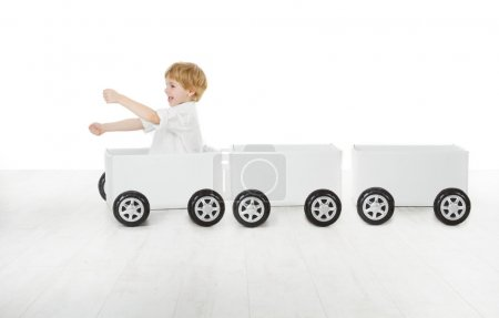 Child driving box car and empty wagons
