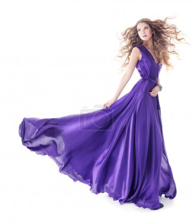 Photo pour Woman in purple silk fluttering waving dress, Beauty Fashion Girl Turning on white background - image libre de droit