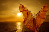 Woman Wings Transform Butterfly, flying on fantasy sunset, meditation reincarnation