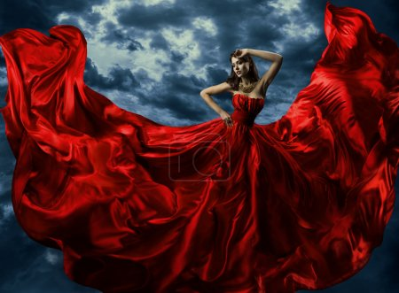 Woman in waving red evening dress