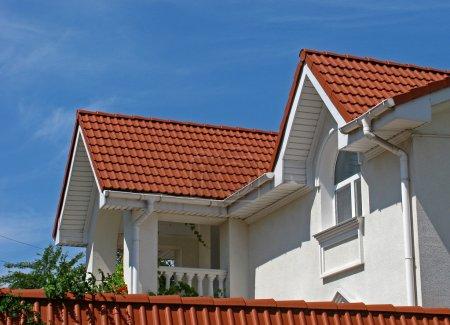 Modern cottage over blue sky