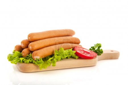 Sausages on wooden cutting board...