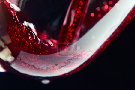 Photo for Red wine on a black background, abstract splashing. - Royalty Free Image