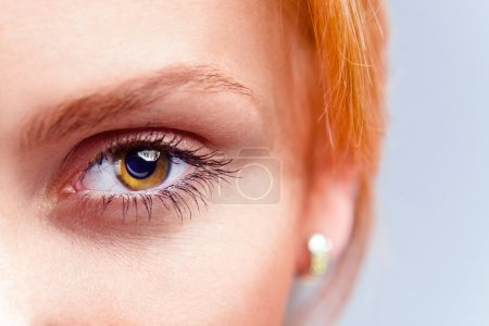 Photo for Eye of young beautiful woman with red hair - Royalty Free Image