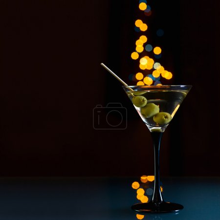 Photo for Glass with martini and green olives on a dark background. - Royalty Free Image