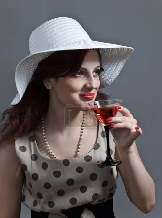 Photo for Young beautiful woman in hat with martini - Royalty Free Image