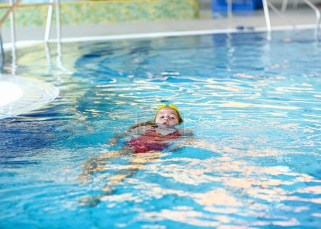 Child swimming backstroke