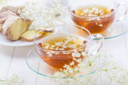 Cup of elder flower tea with ginger