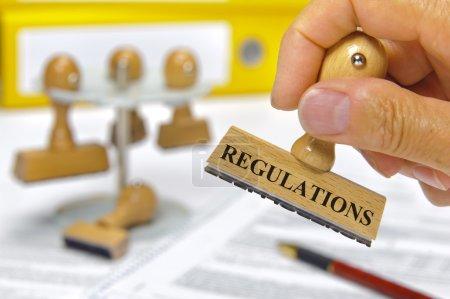 Photo pour Règlements marqués sur timbre en caoutchouc - image libre de droit