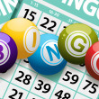 Bingo balls on a Background of Cards