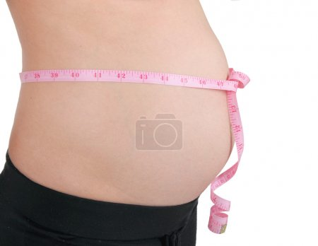 Pregnant woman with pink tape measure