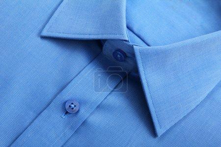Close up view of blue business shirt.