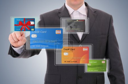 Businessman selecting a credit card