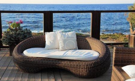 A modern wicker garden sofa