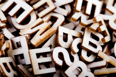 Jumbled wooden letters close up...
