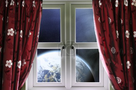 View of the Earth through a window with curtains