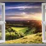 View through an open window onto beautiful landsca...