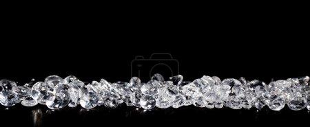 Diamonds on black backgroundPile of diamonds on a black backgrou
