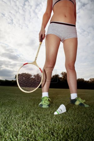 Photo for Part of girl who plays badminton on grass - Royalty Free Image