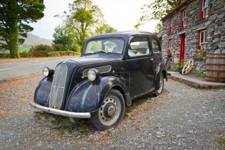 Vintage car at Irish cottage house