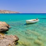 Boat on the blue lagoon of Vai beach, Crete...