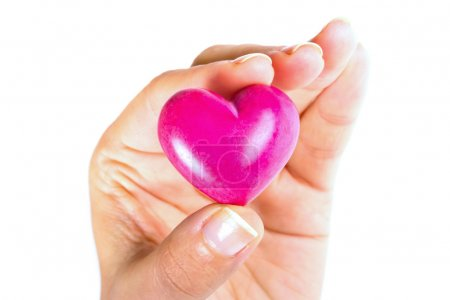 Heart in hand as love and health symbol...