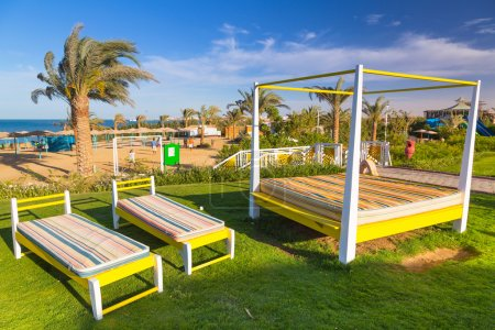 Sunbeds on the beach of tropical resort in Hurghada