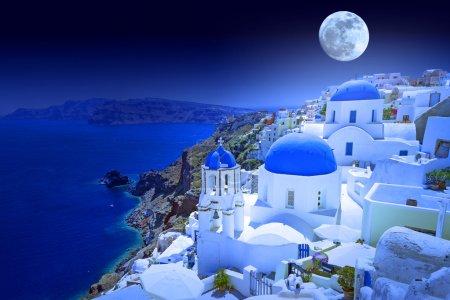 Photo for Full moon over Oia town on Santorini island, Greece - Royalty Free Image