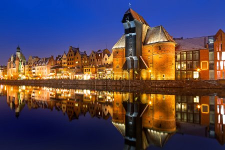 Old town of Gdansk with ancient crane at night