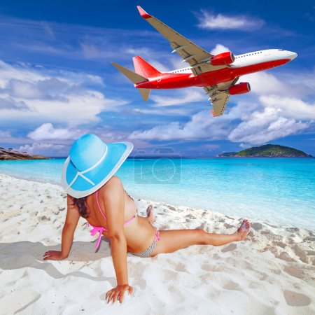 Photo for Woman enjoying tropical holidays on the beach - Royalty Free Image