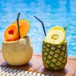 Постер, плакат: Tropical drinks at the pool
