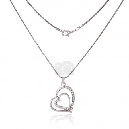 Photo for Silver chain and pendant in the shape of heart - Royalty Free Image