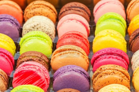 Photo for Traditional french colorful macarons in a rows in a box - Royalty Free Image
