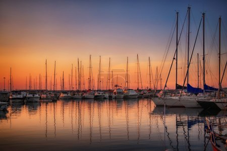 Marina with docked yachts at sunset