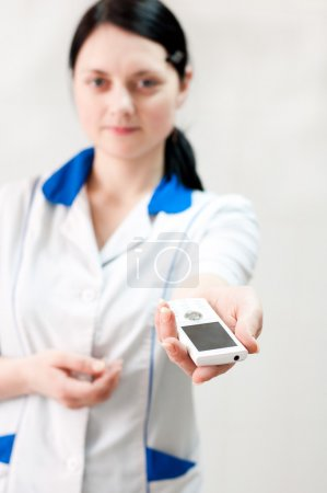 Woman doctor hands mobile phone