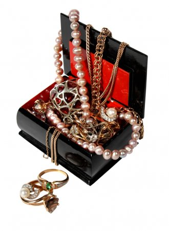 Jewelry box with beads, pearls and jewellery isolated on white background.