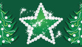 Shining star and Christmas trees on the dark green background